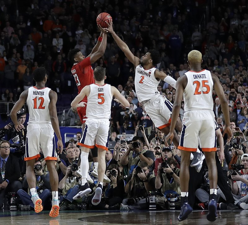 Virginia's Braxton Key (2) blocks a shot by Texas Tech's Jarrett Culver (23) during the second half in the championship of the Final Four NCAA college basketball tournament, Monday, April 8, 2019, in Minneapolis. (AP Photo/David J. Phillip)