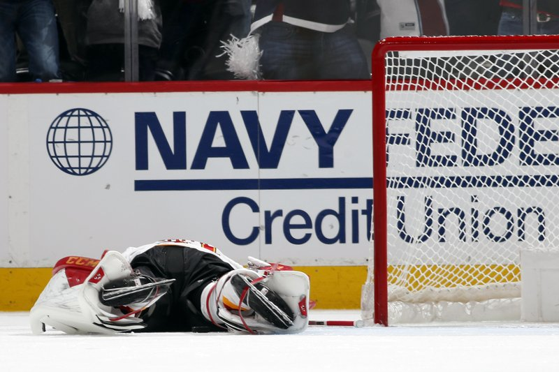 Calgary Flames goaltender Mike Smith reacts after giving up a short-handed goal to Colorado Avalanche left wing Matt Nieto in the second period of Game 3 of a first-round NHL hockey playoff series, Monday, April 15, 2019, in Denver. (AP Photo/David Zalubowski)