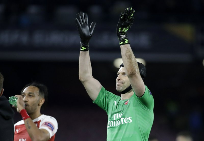 Arsenal's goalkeeper Petr Cech waves to his fans after the Europa League second leg quarterfinal soccer match between Napoli and Arsenal at San Paolo stadium in Naples, Italy, Thursday, April 18, 2019. (AP Photo/Luca Bruno)