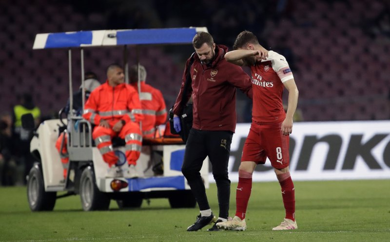 Arsenal's Aaron Ramsey leaves the pitch after his injuring during the Europa League second leg quarterfinal soccer match between Napoli and Arsenal at San Paolo stadium in Naples, Italy, Thursday, April 18, 2019. (AP Photo/Luca Bruno)