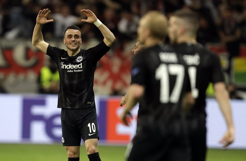 Frankfurt's Filip Kostic, left, celebrates after scoring his side's opening goal during the Europa League quarterfinals, second leg soccer match between Eintracht Frankfurt and Benfica at the Commerzbank Arena in Frankfurt, Germany, Thursday, April 18, 2019. (AP Photo/Michael Probst)