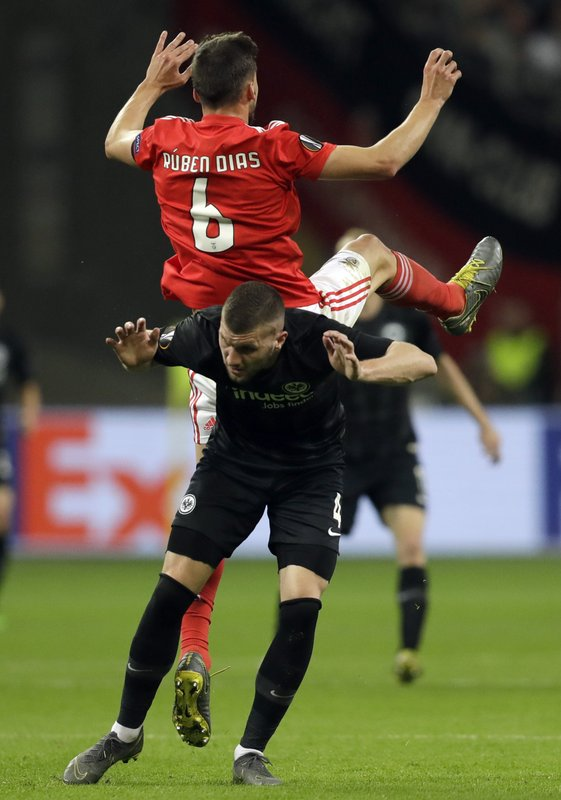 Benfica's Ruben Dias, top, falls on Frankfurt's Ante Rebic during the Europa League quarterfinals, second leg soccer match between Eintracht Frankfurt and Benfica at the Commerzbank Arena in Frankfurt, Germany, Thursday, April 18, 2019. (AP Photo/Michael Probst)