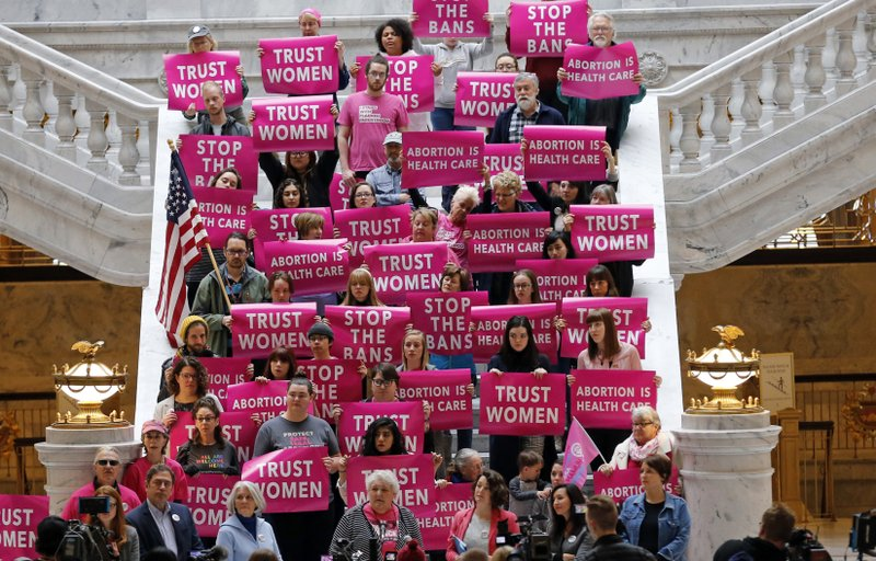 In this April 10, 2019, file photo, abortion rights supporters gather during a news conference at the Utah State Capitol in Salt Lake City. (AP Photo/Rick Bowmer, File)