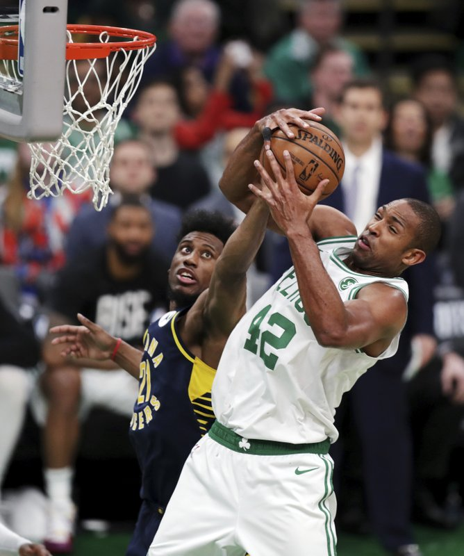 Boston Celtics center Al Horford (42) hauls down a rebound against Indiana Pacers forward Thaddeus Young (21) during the fourth quarter of Game 2 of an NBA basketball first-round playoff series, Wednesday, April 17, 2019, in Boston. (AP Photo/Charles Krupa)