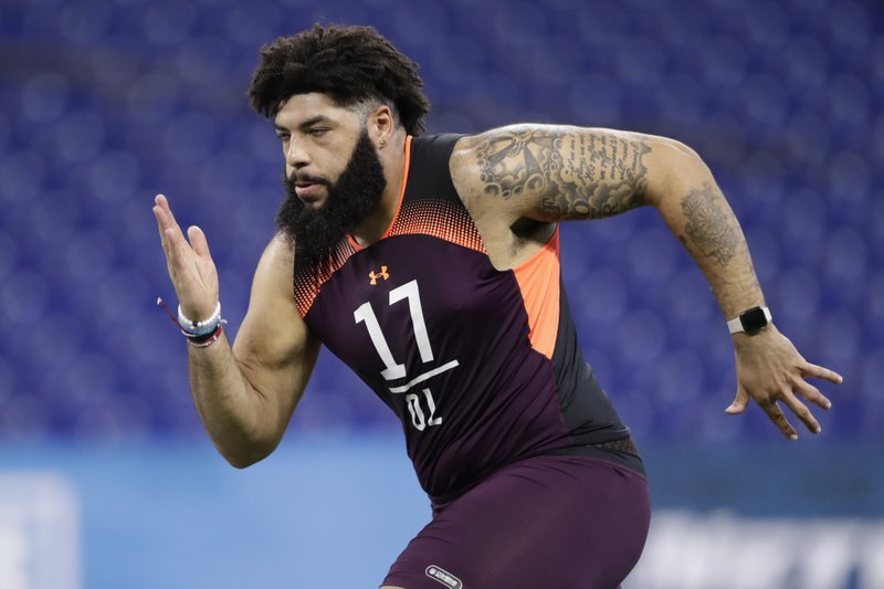FILE - In this March 1, 2019, file photo, Oklahoma offensive lineman Cody Ford runs a drill at the NFL football scouting combine in Indianapolis. (AP Photo/Michael Conroy, File)