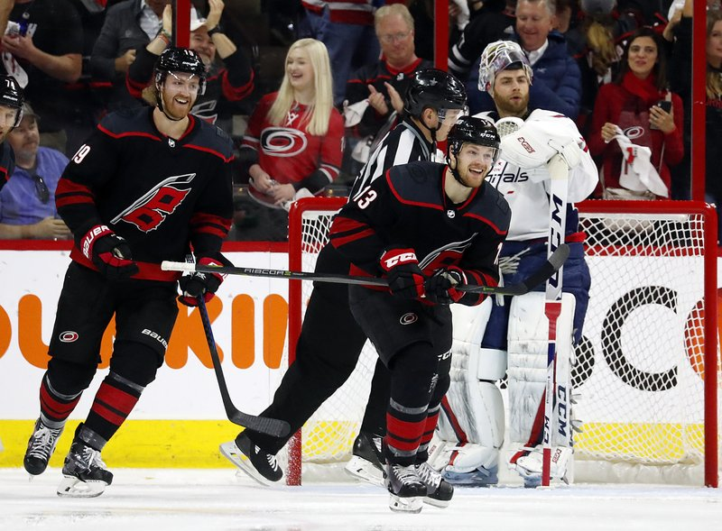 Carolina Hurricanes' Warren Foegele (13) celebrates his goal with Dougie Hamilton (19) nearby during the first period of Game 4 of the team's NHL hockey first-round playoff series against the Washington Capitals in Raleigh, N. (AP Photo/Karl B DeBlaker)