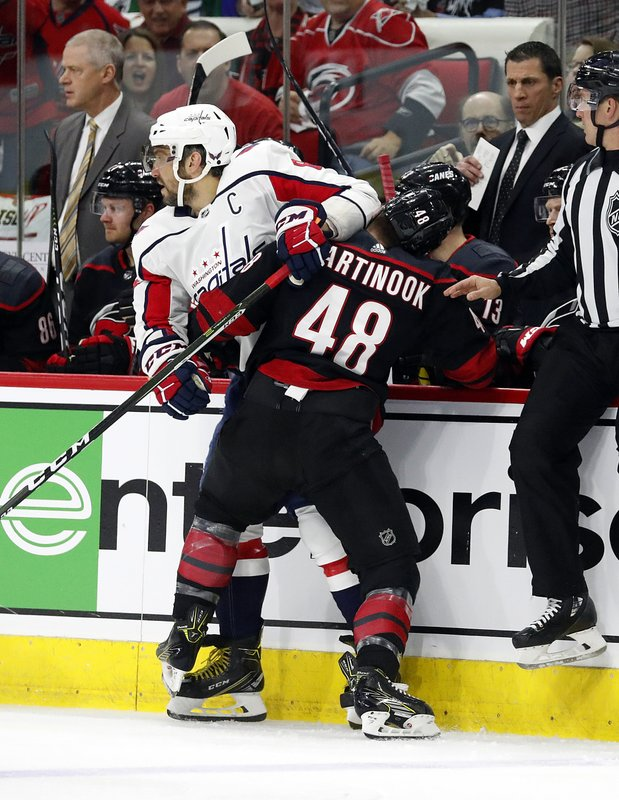 Carolina Hurricanes' Jordan Martinook (48) collides with Washington Capitals' Alex Ovechkin (8), of Russia, during the first period of Game 4 of an NHL hockey first-round playoff series in Raleigh, N. (AP Photo/Karl B DeBlaker)