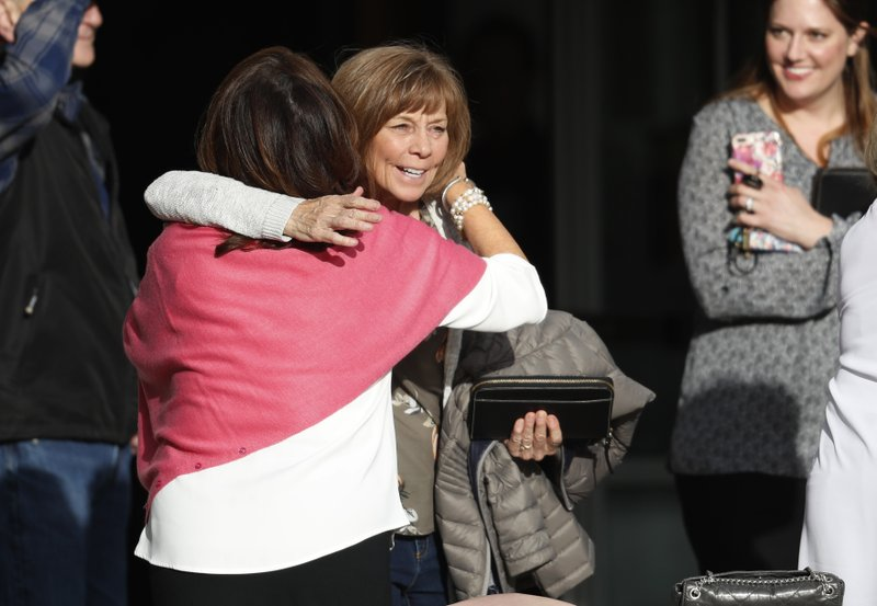 Roxanne Ballard, left, greets another woman as she arrives to attend a faith-based memorial service for the victims of the massacre at Columbine High School nearly 20 years earlier, at a community church, Thursday, April 18, 2019, in Littleton, Colo. (AP Photo/David Zalubowski)
