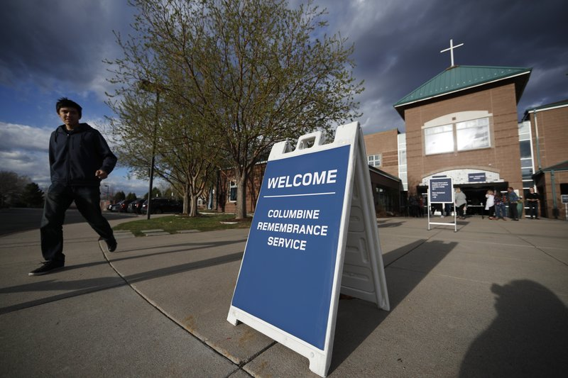 Participants arrive to attend a faith-based memorial service for the victims of the massacre at Columbine High School nearly 20 years ago at a community church Thursday, April 18, 2019, in Littleton, Colo. (AP Photo/David Zalubowski)