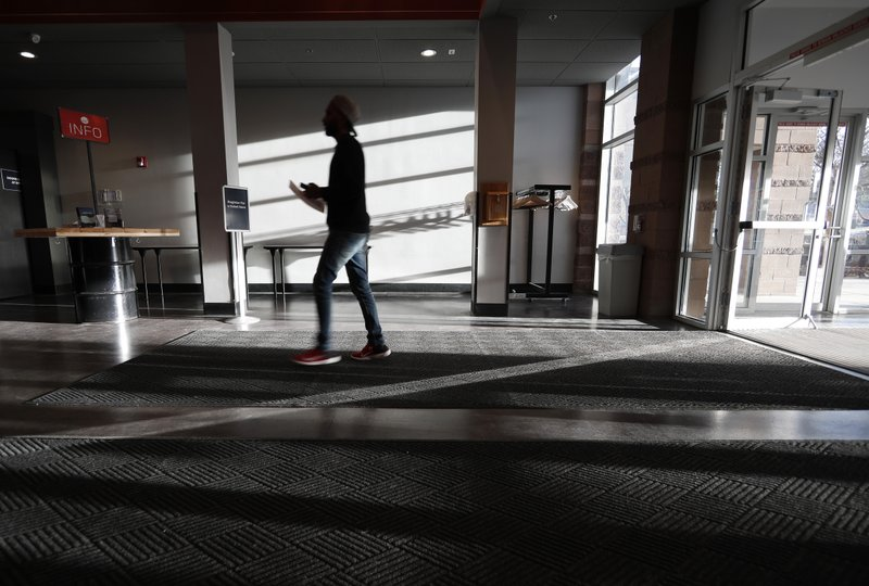 A participant arrives to attend a faith-based memorial service for the victims of the massacre at Columbine High School nearly 20 years ago at a community church Thursday, April 18, 2019, in Littleton, Colo. (AP Photo/David Zalubowski)