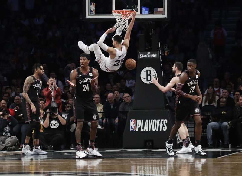 Brooklyn Nets' Rondae Hollis-Jefferson (24), Caris LeVert (22) and D'Angelo Russell (1) react to a dunk by Philadelphia 76ers' Ben Simmons (25) during the second half in Game 3 of a first-round NBA basketball playoff series Thursday, April 18, 2019, in New York. (AP Photo/Frank Franklin II)