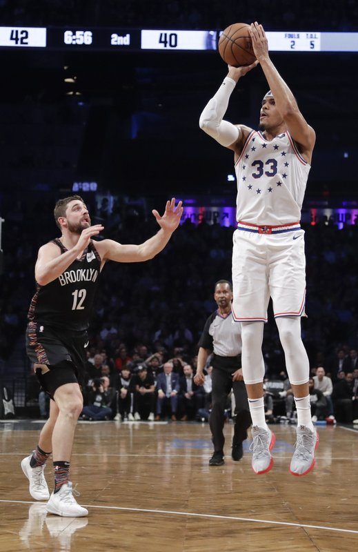 Philadelphia 76ers' Tobias Harris (33) shoots over Brooklyn Nets' Joe Harris (12) during the first half in Game 3 of a first-round NBA basketball playoff series Thursday, April 18, 2019, in New York. (AP Photo/Frank Franklin II)