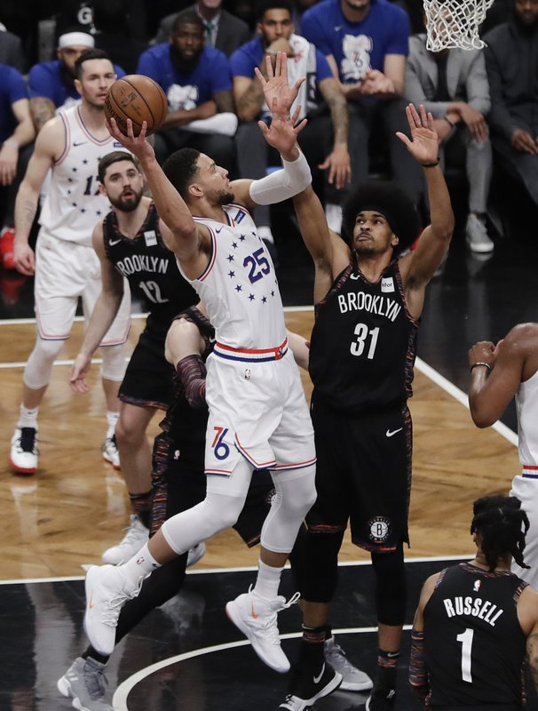 Philadelphia 76ers' Ben Simmons (25) shoots over Brooklyn Nets' Jarrett Allen (31) during the first half in Game 3 of a first-round NBA basketball playoff series Thursday, April 18, 2019, in New York. (AP Photo/Frank Franklin II)