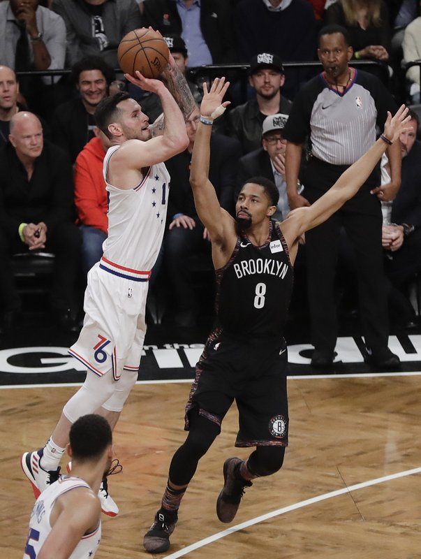 Philadelphia 76ers' JJ Redick, left, shoots over Brooklyn Nets' Spencer Dinwiddie (8) during the first half in Game 3 of a first-round NBA basketball playoff series Thursday, April 18, 2019, in New York. (AP Photo/Frank Franklin II)