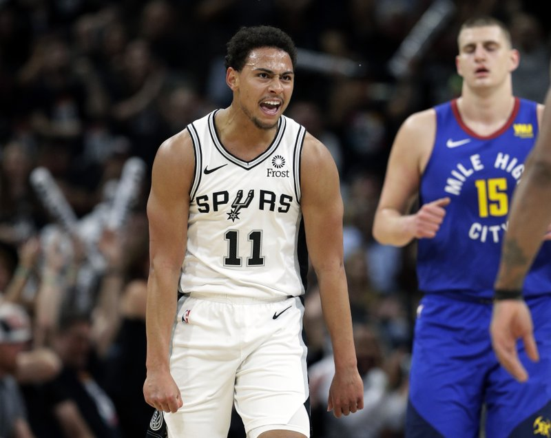 San Antonio Spurs guard Bryn Forbes (11) reacts after scoring against the Denver Nuggets during the first half of Game 3 of an NBA basketball playoff series in San Antonio, Thursday, April 18, 2019. (AP Photo/Eric Gay)
