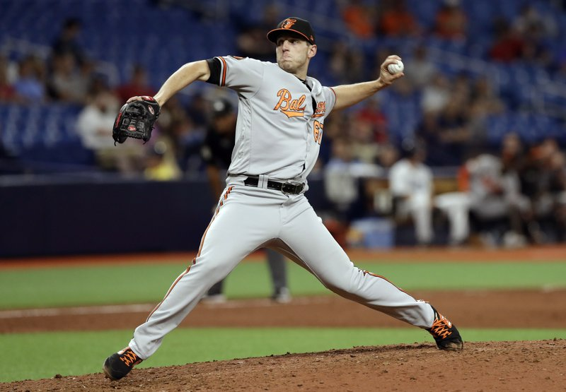 Baltimore Orioles pitcher John Means delivers to the Tampa Bay Rays during the 11th inning of a baseball game Thursday, April 18, 2019, in St. (AP Photo/Chris O'Meara)
