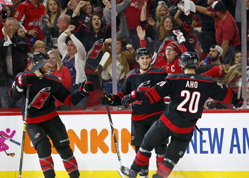 Carolina Hurricanes' Teuvo Teravainen (86) of Finland, celebrates his goal against the Washington Capitals with teammates Sebastian Aho (20) of Finland, and Jaccob Slavin (74) during the second period of Game 4 of an NHL hockey first-round playoff series in Raleigh, N. (AP Photo/Karl B DeBlaker)