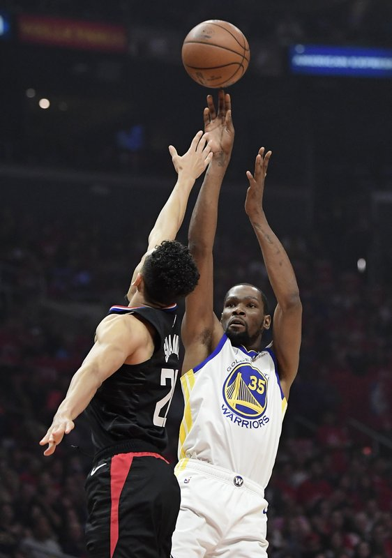 Golden State Warriors forward Kevin Durant, right, shoots as Los Angeles Clippers guard Landry Shamet defends during the first half in Game 3 of a first-round NBA basketball playoff series Thursday, April 18, 2019, in Los Angeles. (AP Photo/Mark J. Terrill)