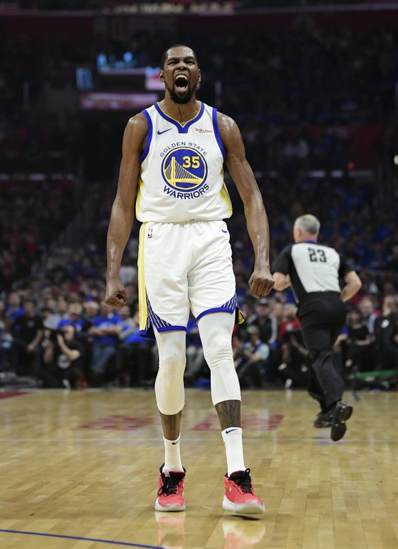Golden State Warriors forward Kevin Durant celebrates after scoring during the first half in Game 3 of the team's first-round NBA basketball playoff series against the Los Angeles Clippers on Thursday, April 18, 2019, in Los Angeles. (AP Photo/Mark J. Terrill)