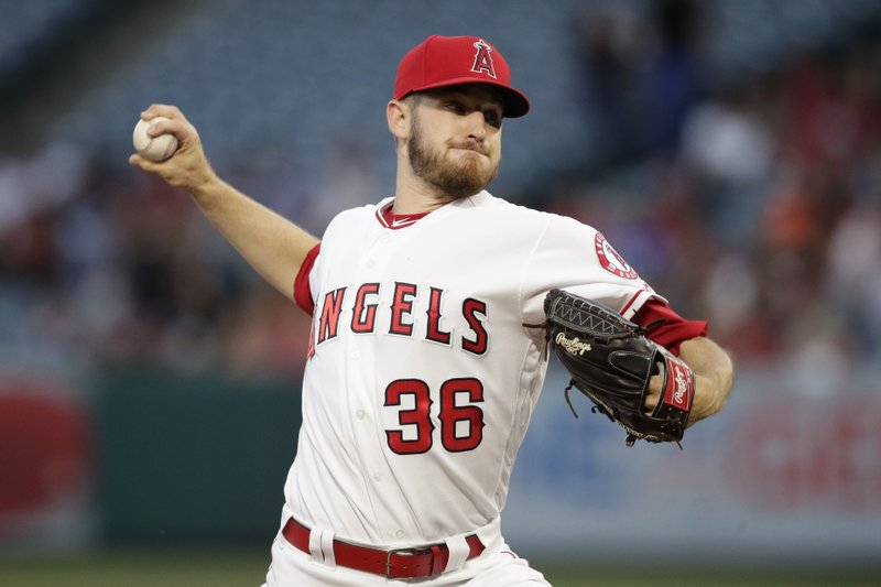 Los Angeles Angels starting pitcher Chris Stratton throws to a Seattle Mariners batter during the first inning of a baseball game Thursday, April 18, 2019, in Anaheim, Calif. (AP Photo/Jae C. Hong)
