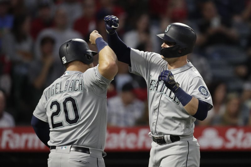 Seattle Mariners' Ryon Healy, right, celebrates his three-run home run with Daniel Vogelbach during the second inning of a baseball game against the Los Angeles Angels, Thursday, April 18, 2019, in Anaheim, Calif. (AP Photo/Jae C. Hong)