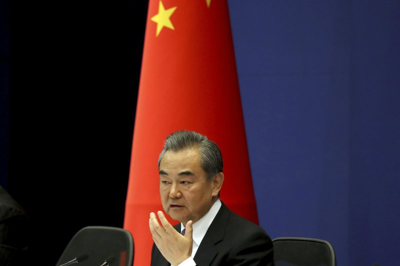 Chinese Foreign Minister Wang Yi answers media questions during a press conference on the upcoming Road and Belt Forum in Beijing on Friday, April 19, 2019. (AP Photo/Ng Han Guan)