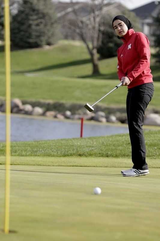 In this April 10, 2019 photo, Noor Ahmed, a member of the Nebraska NCAA college golf team, putts during a practice session in Lincoln, Neb. (AP Photo/Nati Harnik)
