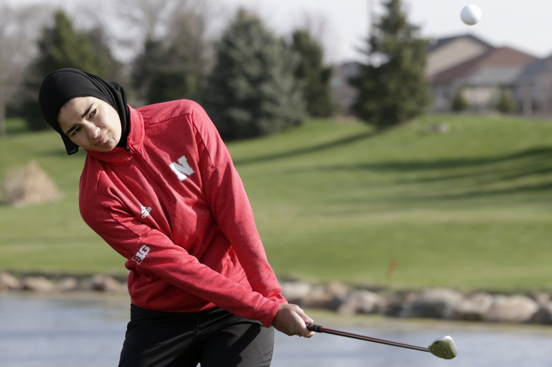 In this April 10, 2019 photo, Noor Ahmed, a member of the Nebraska NCAA college golf team, hits the ball during practice in Lincoln, Neb. (AP Photo/Nati Harnik)