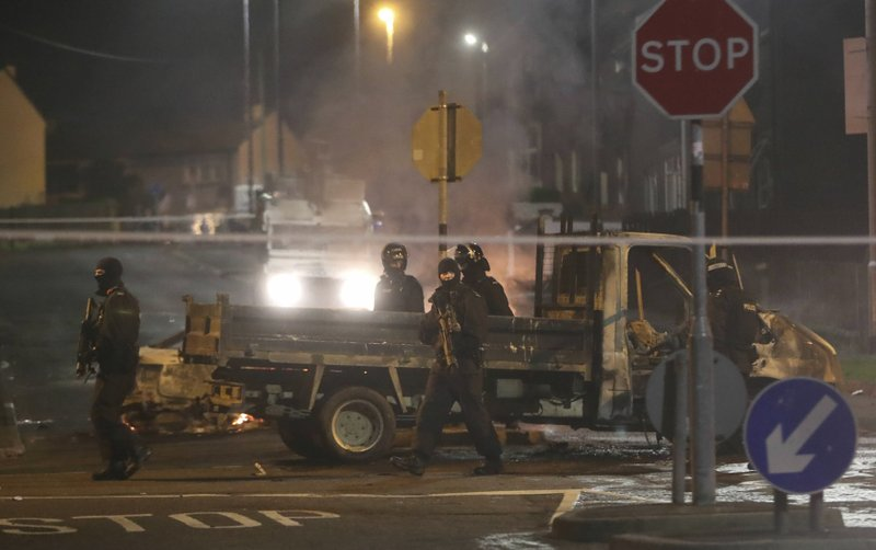 Police guard a crime scene during unrest in the Creggan area of Londonderry, in Northern Ireland, Thursday, April 18, 2019. (Niall Carson/PA via AP)
