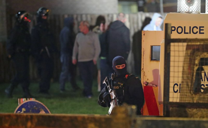 Armed police stage at the scene of unrest in Creggan, Londonderry, in Northern Ireland, Thursday, April 18, 2019. (Niall Carson/PA via AP)