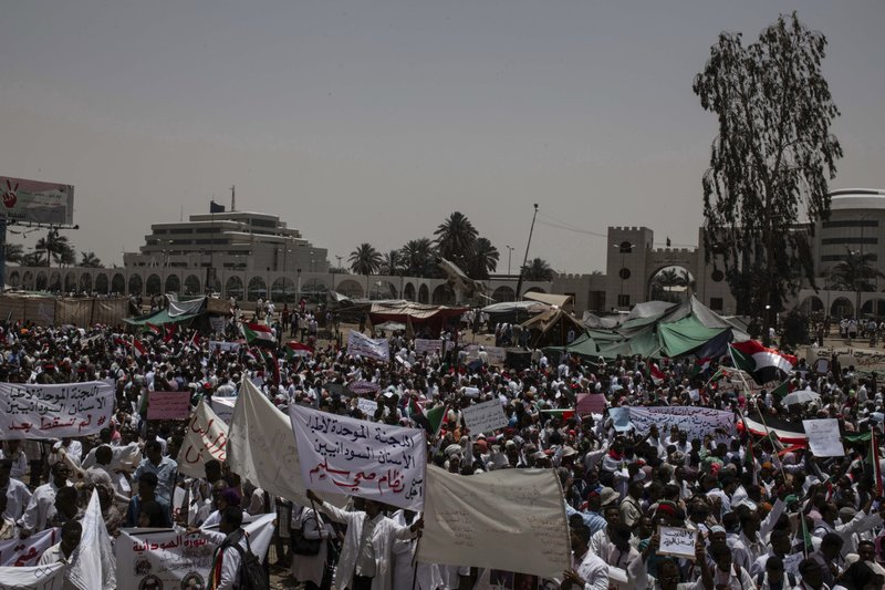 A group of protesters from the Sudanese medical profession syndicate march at the sit-in inside the Armed Forces Square, in Khartoum, Sudan, Wednesday, April 17, 2019. (AP Photos/Salih Basheer)