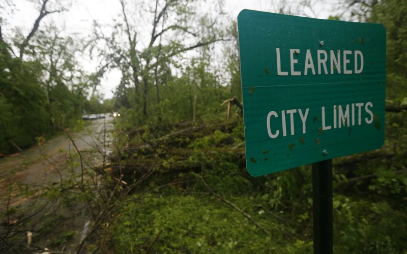 Fallen trees line the roads leading into the small community of Learned, Miss., Thursday, April 18, 2019. (AP Photo/Rogelio V. Solis)