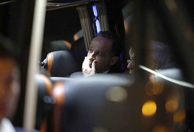 German Foreign Minister Heiko Maas sits in a minivan outside the hospital in Funchal, the capital of Portugal's Madeira Island, Thursday April 18, 2019 after visiting people injured in the bus crash. (AP Photo/Armando Franca)