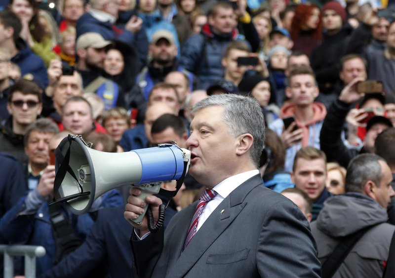 FILE - In this Sunday, April 14, 2019 file photo, Ukrainian President Petro Poroshenko talks to his supporters ahead of the presidential elections, at the Olympic stadium in Kiev, Ukraine. (AP Photo/Efrem Lukatsky, file)