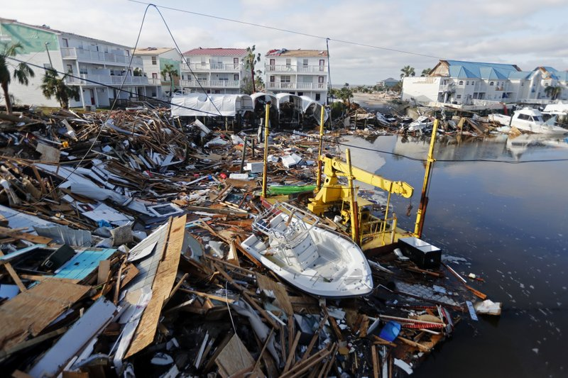 FILE - In this Oct. 11, 2018 file photo, a boat sits amidst debris in the aftermath of Hurricane Michael in Mexico Beach, Fla. (AP Photo/Gerald Herbert, File)