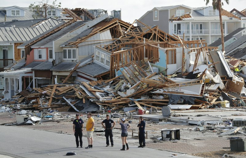 FILE-In this Thursday, Oct. 11, 2018. file photo, rescue personnel perform a search in the aftermath of Hurricane Michael in Mexico Beach, Fla. (AP Photo/Gerald Herbert, File)