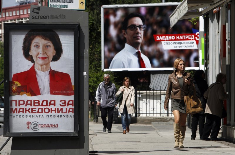 Campaign posters of Gordana Siljanovska Davkova, left, a candidate for the opposition conservative VMRO-DPMNE party, which reads in Macedonian