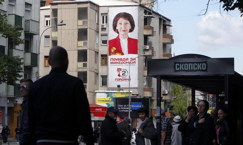 A large campaign poster of Gordana Siljanovska Davkova, a candidate for the opposition conservative VMRO-DPMNE party, reading in Macedonian