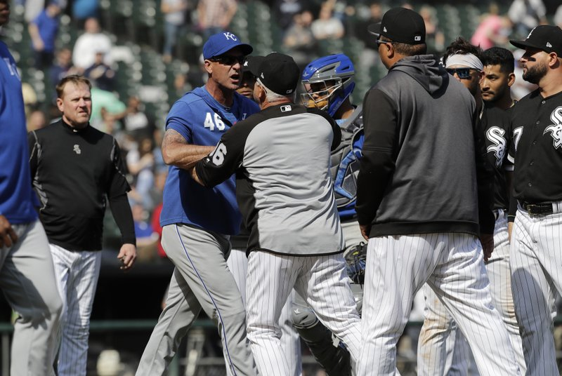 Kansas City Royals bench coach Dale Sveum (46) and Chicago White Sox manager Rick Renteria shove each other as benches clear after Chicago White Sox's Tim Anderson was hit by a pitch during the sixth inning of a baseball game in Chicago, Wednesday, April 17, 2019. (AP Photo/Nam Y. Huh)