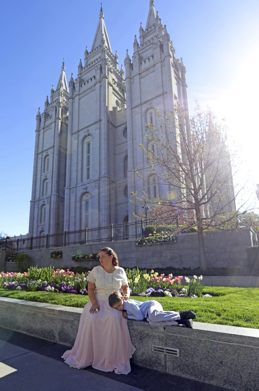 Salt Lake Temple is shown Friday, April 19, 2019, in Salt Lake City.  The iconic temple central to The Church of Jesus Christ of Latter-day Saints faith will close for four years to complete a major renovation, and officials are keeping a careful eye on construction plans after a devastating fire at Notre Dame cathedral in Paris. (AP Photo/Rick Bowmer)