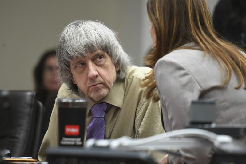 David Turpin listens to his attorney, Allison Lowe, during a sentencing hearing Friday, April 19, 2019, in Riverside, Calif. (Will Lester/The Orange County Register via AP, Pool)