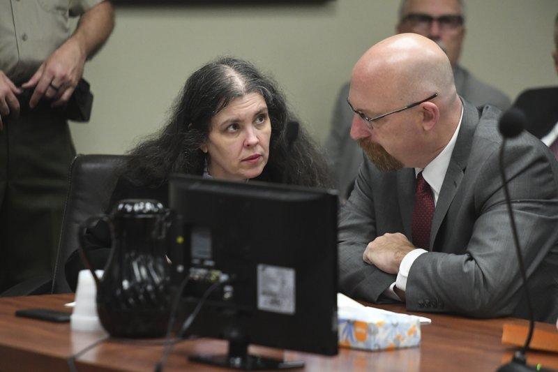 Louise Turpin, left, listens to her attorney, Jeff Moore, during a sentencing hearing Friday, April 19, 2019, in Riverside, Calif. (Will Lester/The Orange County Register via AP, Pool)