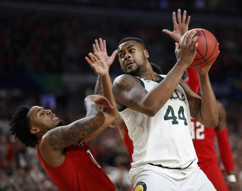 Michigan State's Nick Ward (44) drives against Texas Tech's Kyler Edwards (0) during the second half in the semifinals of the Final Four NCAA college basketball tournament, Saturday, April 6, 2019, in Minneapolis. (AP Photo/Jeff Roberson)