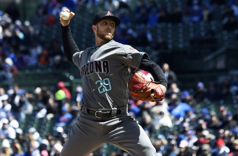 Arizona Diamondbacks starting pitcher Merrill Kelly (29) throws against the Chicago Cubs during the first inning of a baseball game, Friday, April 19, 2019, in Chicago. (AP Photo/David Banks)