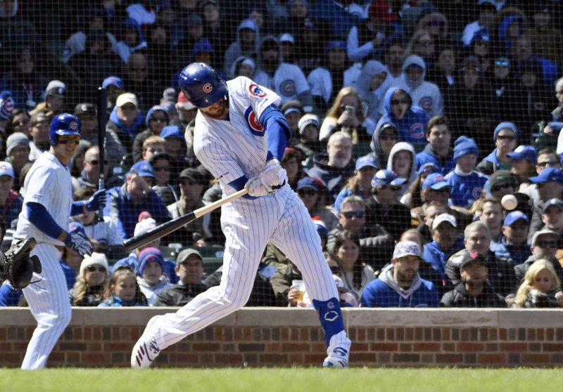 Chicago Cubs' Kris Bryant hits a two-run double against the Arizona Diamondbacks during the second inning of a baseball game, Friday, April 19, 2019, in Chicago. (AP Photo/David Banks)