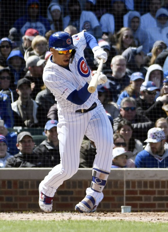 Chicago Cubs' Javier Baez (9) attempts a bunt against the Arizona Diamondbacks during the second inning of a baseball game, Friday, April 19, 2019, in Chicago. (AP Photo/David Banks)