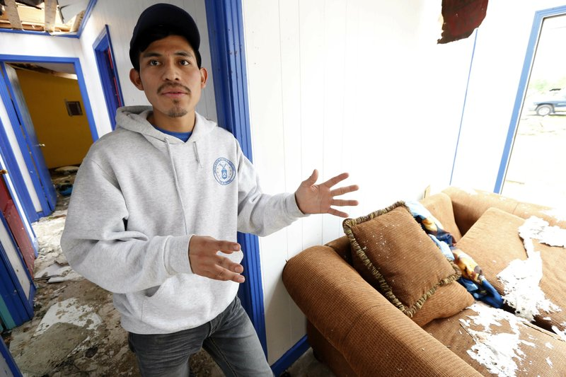 Andres Aguilar, a native of Guatemala, says Friday, April 19, 2019, that he and other family members were very scared when they heard the winds of a possible tornado hit their Morton, Miss. (AP Photo/Rogelio V. Solis)