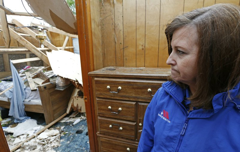 Janet Shoemaker gasps as she looks into the bedroom of what had been a family member's home, Friday, April 19, 2019 in Morton, Miss. (AP Photo/Rogelio V. Solis)