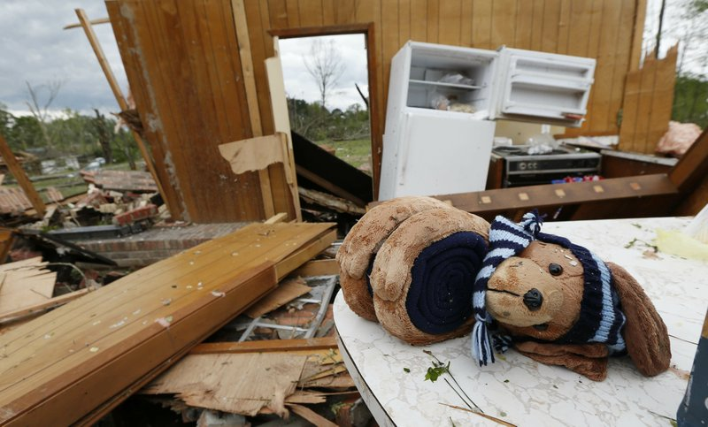 A stuffed puppy dog lay across a kitchen table in this storm damaged home in Morton, Miss., Friday, April 19, 2019. (AP Photo/Rogelio V. Solis)