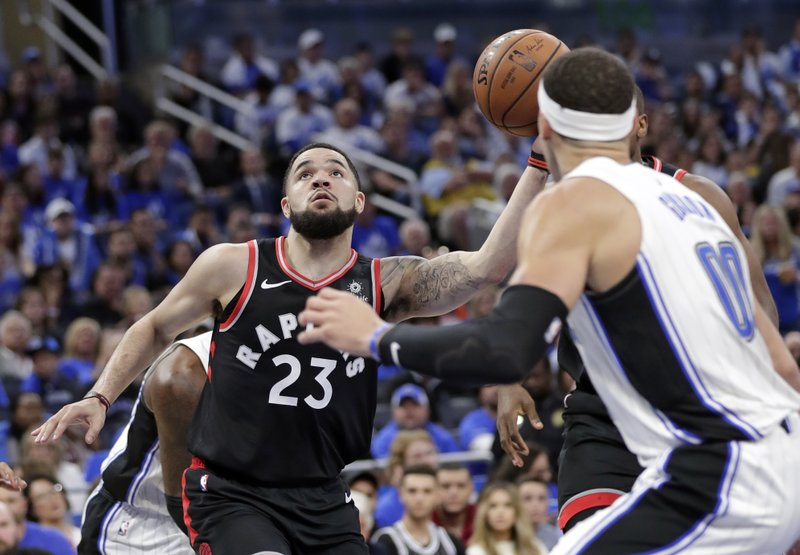 Toronto Raptors' Fred VanVleet (23) looks for a shot against Orlando Magic's Aaron Gordon (00) during the first half in Game 3 of a first-round NBA basketball playoff series, Friday, April 19, 2019, in Orlando, Fla. (AP Photo/John Raoux)